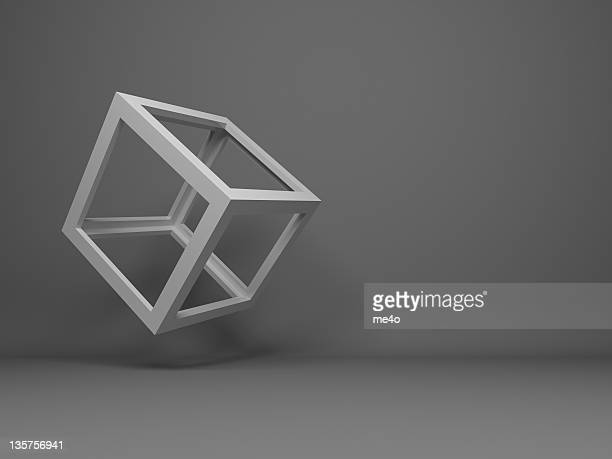 Abstract 3D frame-only cube flying on a gray background