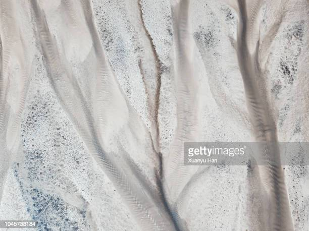 abstract aerial view of river bed - beige stock pictures, royalty-free photos & images