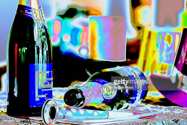 Abstract and colorful empty champagne bottles, noise makers, party hats left after the party is over along with the hangover and the mess of cleaning...