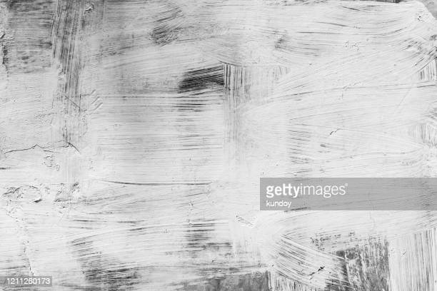 abstract art background from white color painted on black wood background. retro or vintage backdrop. - paint textures stock pictures, royalty-free photos & images