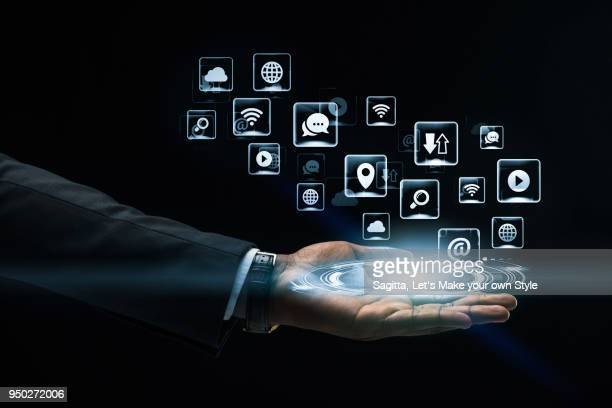 Abstract art Hand of Business man holding virtual hologram. Business and technology concept.