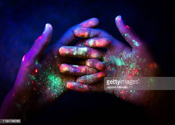 abstract. art. hands. ultraviolet. particles. universe. - cultures ストックフォトと画像