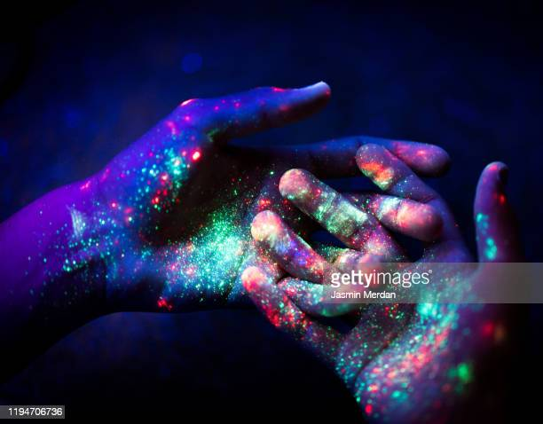 abstract. art. hands. ultraviolet. particles. universe. - lsd stock pictures, royalty-free photos & images