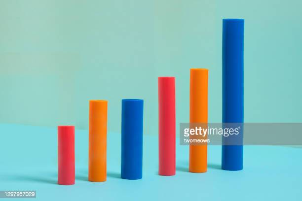 abstract ascending coloured bar on blue background still life. - chart stock pictures, royalty-free photos & images