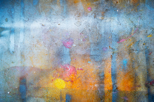 Abstract background from colorful painted on wall with grunge and scratched. Art retro and vintage backdrop. 1084390994