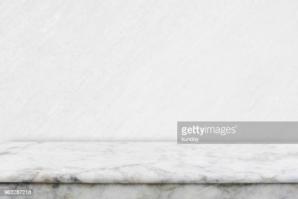 abstract background from empty white marble table top for showing product advertising with white concrete background. picture for add text message. backdrop for design art work. - テーブル ストックフォトと画像