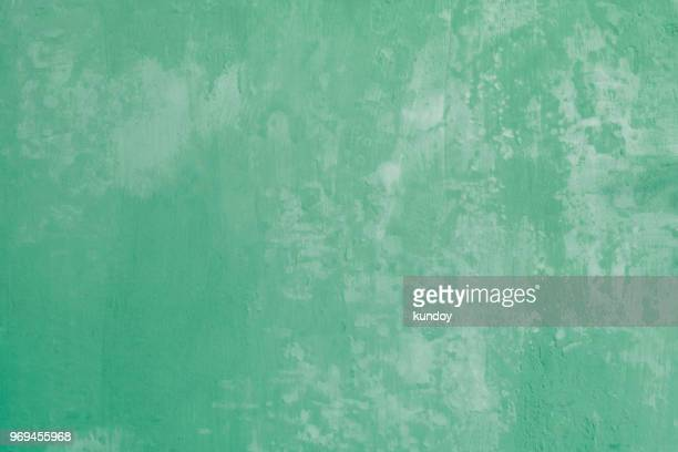 abstract background from old green concrete wall texture with grunge. vintage painted wallpaper. picture for add text message. backdrop for design art work. - grunge bildtechnik stock-fotos und bilder