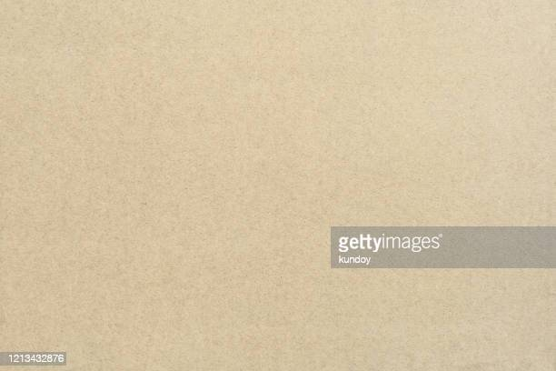 abstract background from texture of brown paper. vintage style backdrop. - ボール紙 ストックフォトと画像