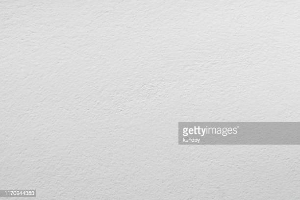 abstract background from white concrete texture on wall. - wand stock-fotos und bilder