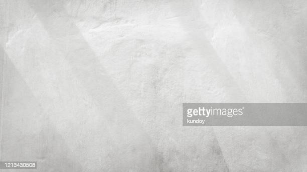 abstract background from white concrete wall with sunlight, light and shadow. - grey colour stock pictures, royalty-free photos & images