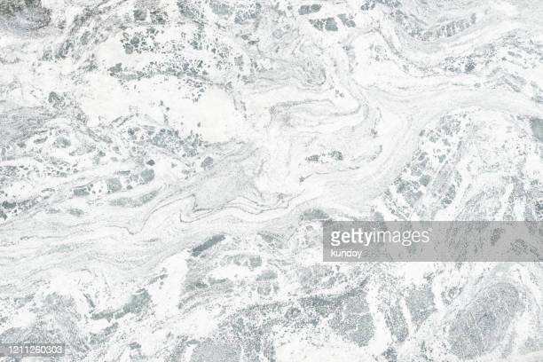 abstract background from white marble texture pattern in nature with sunlight. luxury material for construction or decoration on building. picture for add text message. backdrop for design art work. - marmo bianco foto e immagini stock