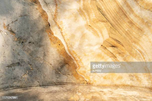 abstract background from yellow marble texture on wall with sunlight. - 大理石 ストックフォトと画像