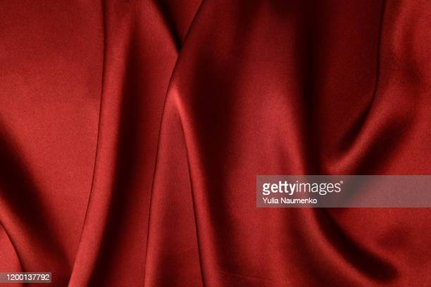 abstract background luxury cloth. wavy folds of grunge red silk texture satin velvet material or luxurious red silk as background, folds of red silky fabric. - velvet stock pictures, royalty-free photos & images