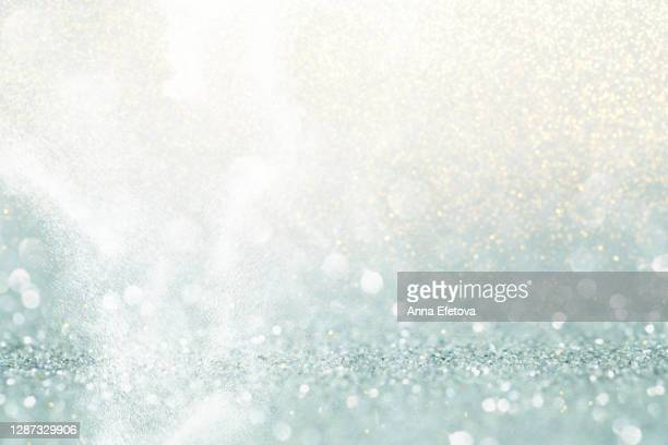 abstract background made with illuminating glittering sparkles. new year coming concept. - star shape stock pictures, royalty-free photos & images