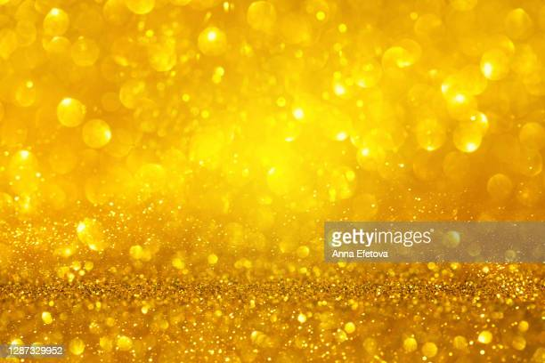 abstract background made with illuminating glittering sparkles. new year coming concept. - shiny stock pictures, royalty-free photos & images