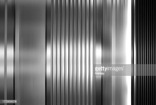 abstract background of vertical stainless steel panels - silver coloured stock pictures, royalty-free photos & images