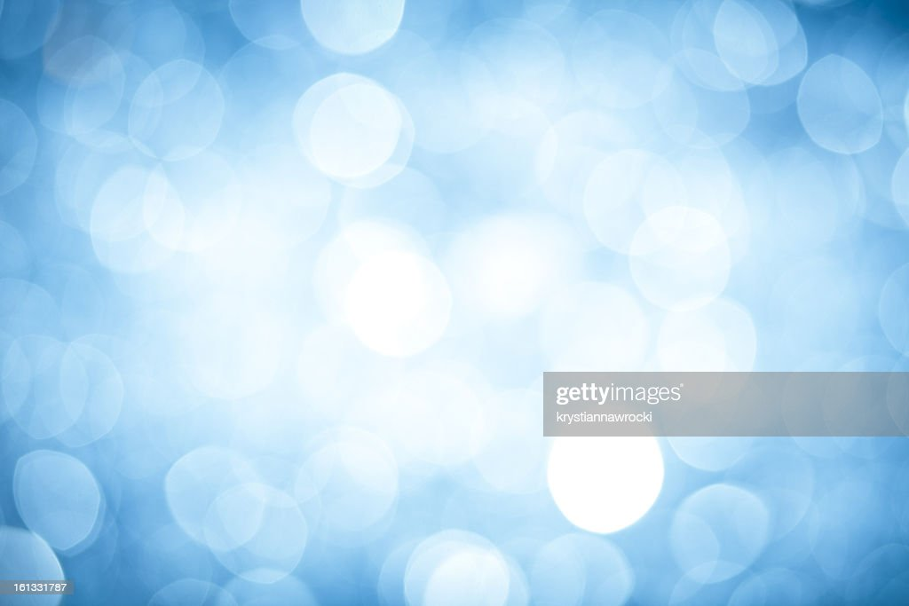 Abstract background with blurred blue sparkles : Stock Photo
