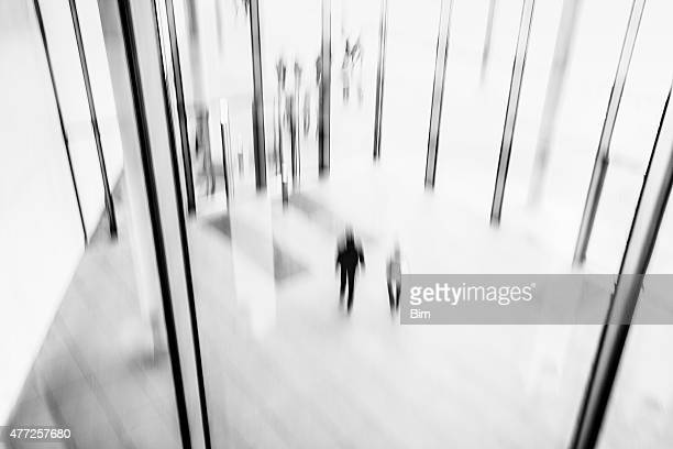 abstract black and white image of lobby with blurred people - bokeh museum stock photos and pictures