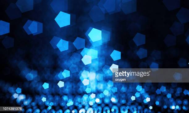 abstract blue bokeh sparkling spray hexagon - dark blue stock pictures, royalty-free photos & images