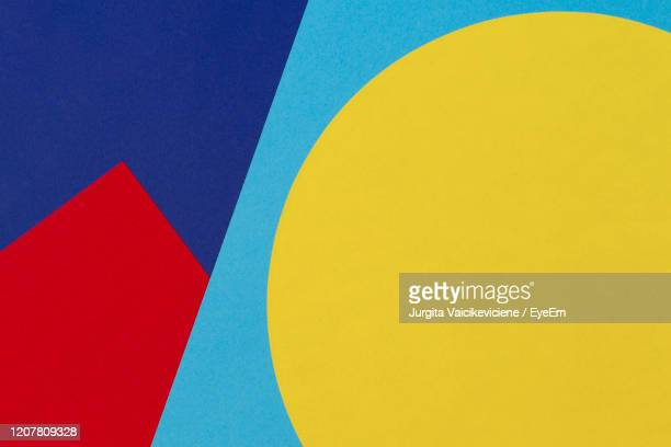 abstract blue, red and yellow color paper geometry composition background. - geometria fotografías e imágenes de stock