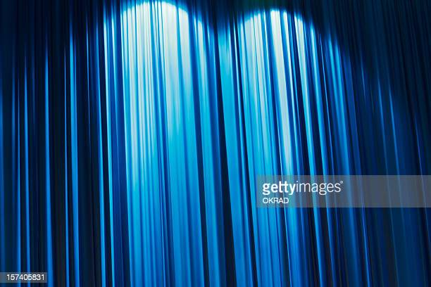 abstract blue stage curtain wallpaper background. - stage curtain stock pictures, royalty-free photos & images