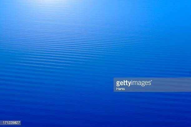 Abstract blue water background with horizontal stripes