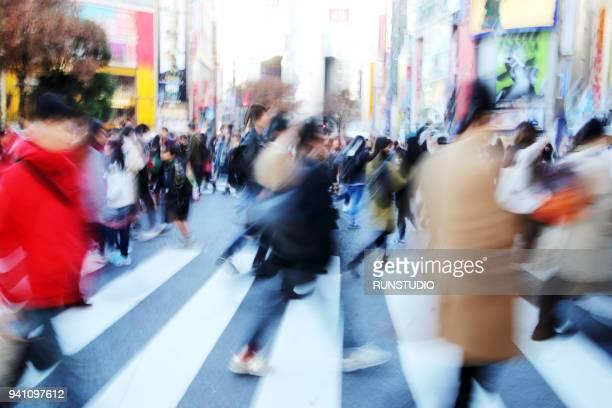 Abstract blur crowd people on crosswalk at Shibuya town in Tokyo, Japan