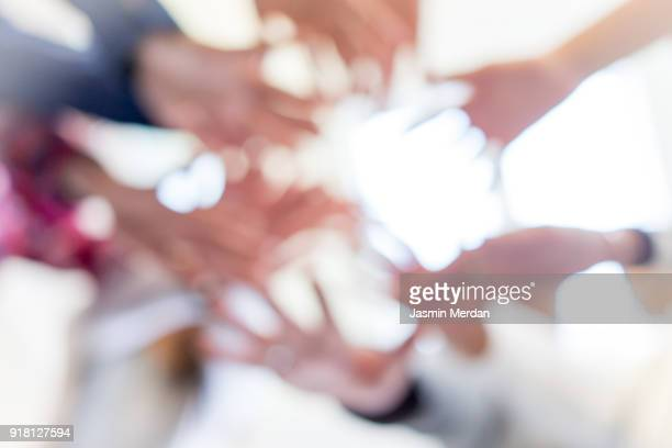Abstract blurred hands together