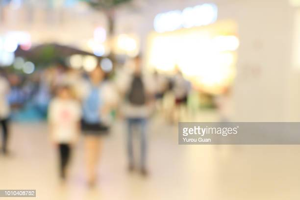 abstract blurred image of shopping mall and people. abstract backgrounds. - market retail space stock pictures, royalty-free photos & images