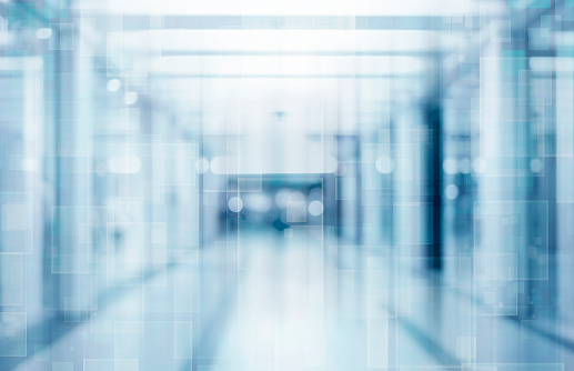 Abstract blurred interior of corridor clinic background in blue color , blurry image 1138910853