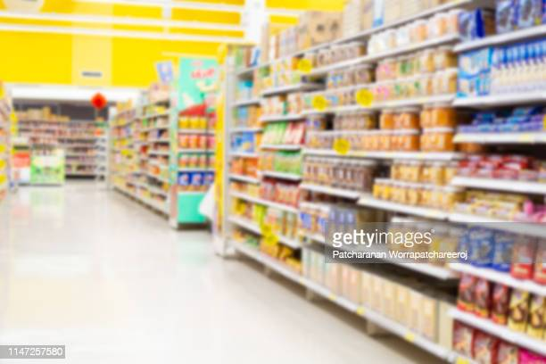 abstract blurred supermarket for background. - produce aisle stock pictures, royalty-free photos & images