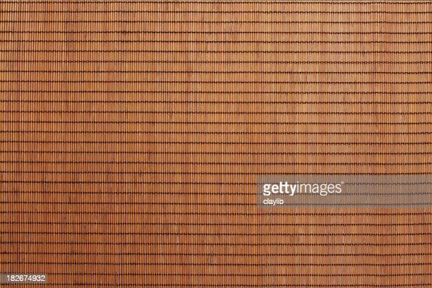 抽象的なブラウンの籐のマット
