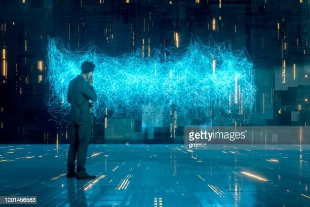 電話で抽象的なビジネスマン - データマイニング ストックフォトと画像