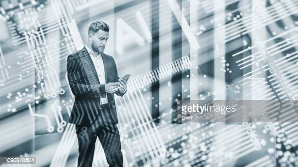 abstract businessman using ai smart phone - toned image stock pictures, royalty-free photos & images