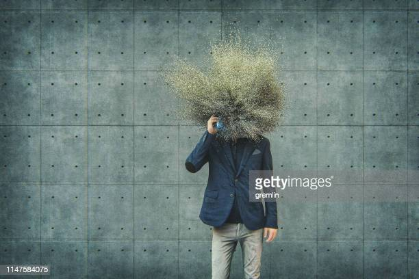 abstract businessman with exploding head - cabeça imagens e fotografias de stock