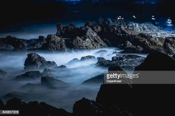 Abstract cliffs and waves at night