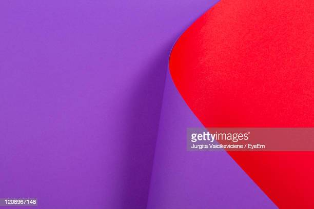 abstract colorful background. red violet purple color paper in geometric shapes - colour block stock pictures, royalty-free photos & images