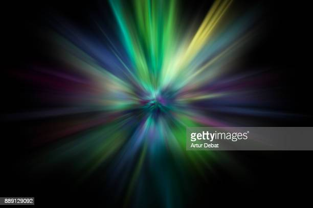 Abstract colorful powder explosion in all directions in a nice composition with vivid colors, black background and diminishing perspective.