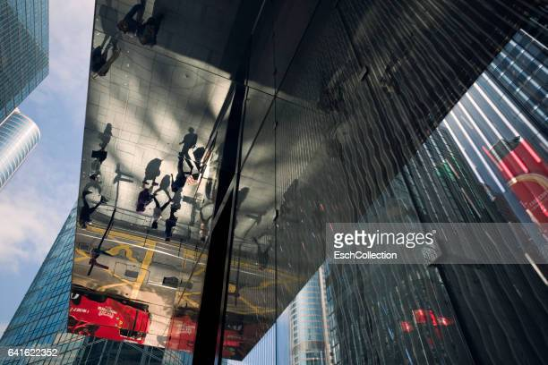 Abstract composition of office facades and reflection of people
