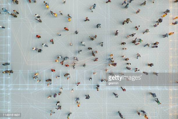 abstract crowds of people with virtual reality street display - data stock pictures, royalty-free photos & images
