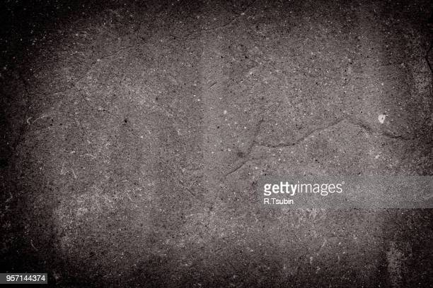abstract dark background of elegant vintage grunge texture black on border with light center blank
