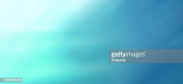 abstract defocused background - azul turquesa fotografías e imágenes de stock