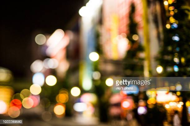 abstract defocused city street scene at night - nightlife stock pictures, royalty-free photos & images
