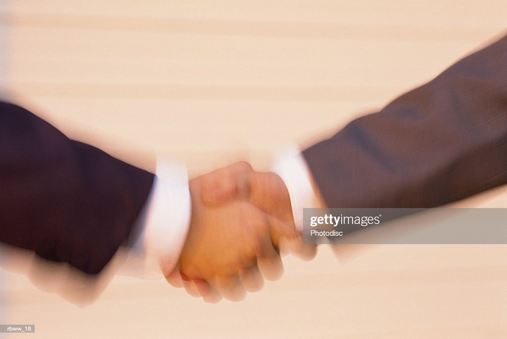 abstract detail of two businessmen shaking hands : Foto de stock