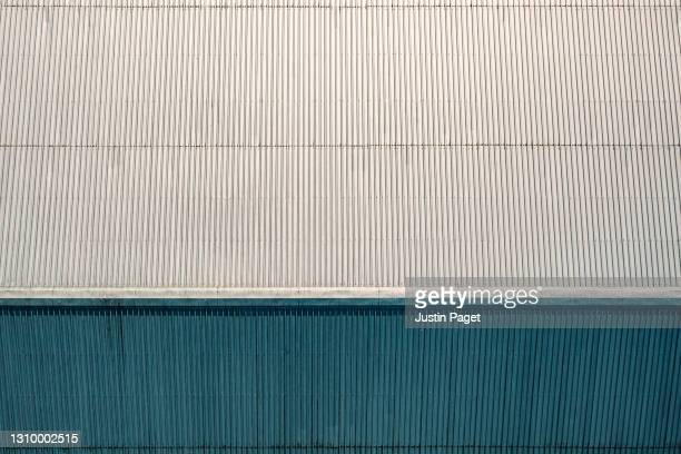 abstract drone view of the roof of an industrial building - metallic stock pictures, royalty-free photos & images