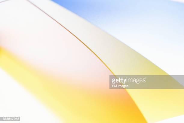 Abstract edge of yellow plastic sheet