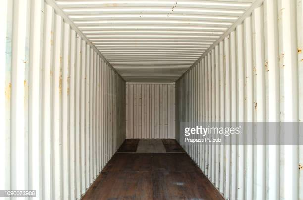 abstract empty in side container with  white light outside. - cargo container stock pictures, royalty-free photos & images
