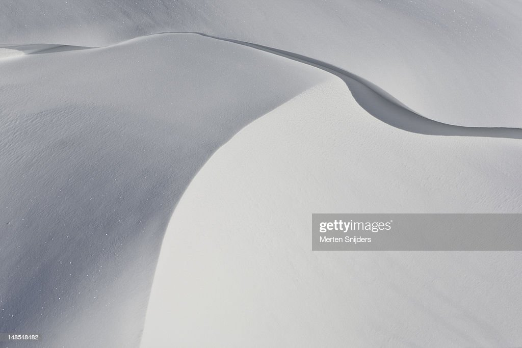Abstract eroded snow shapes. : Stockfoto
