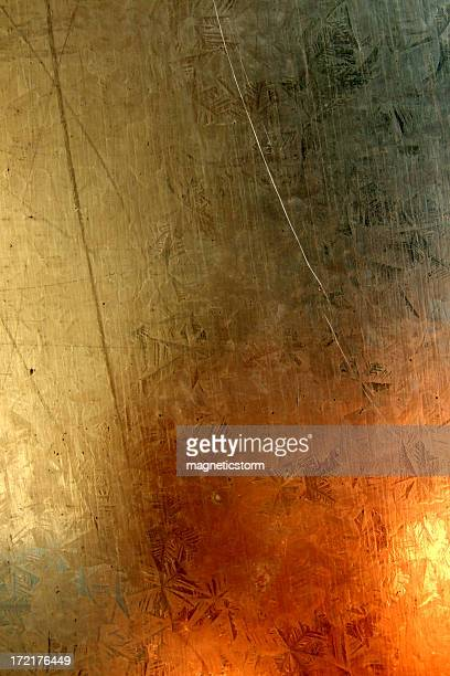 Abstract explosion-like reflections on a metal plate