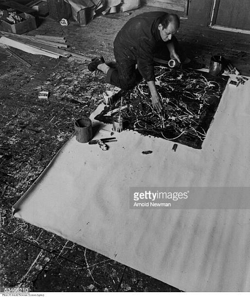 Abstract Expressionist painter Jackson Pollock at work in his Long Island studio January 3 1949 in East Hampton New York